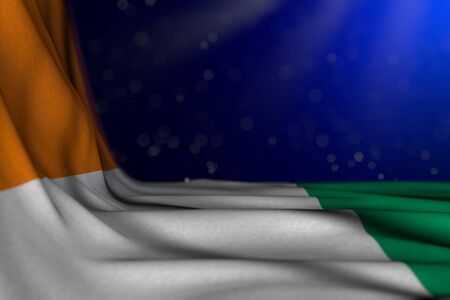 pretty day of flag 3d illustration  - dark picture of Cote d Ivoire flag lying flat diagonal on blue background with soft focus and empty place for your text
