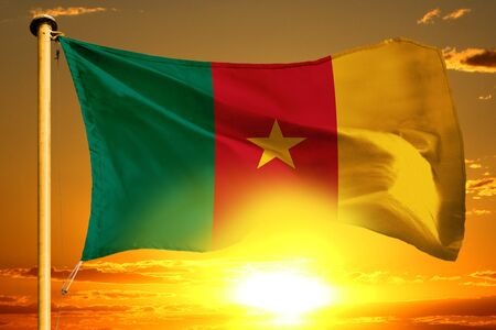 Cameroon flag weaving on the beautiful orange sunset background