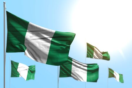 wonderful feast flag 3d illustration  - 5 flags of Nigeria are wave against blue sky image with bokeh Stok Fotoğraf