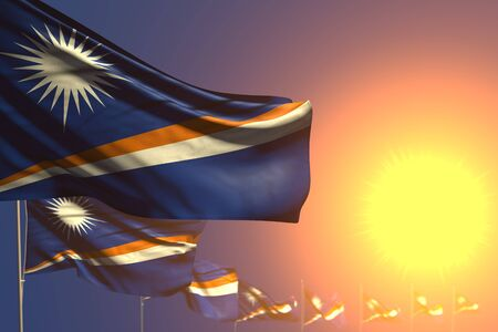 beautiful anthem day flag 3d illustration  - many Marshall Islands flags on sunset placed diagonal with selective focus and place for your text