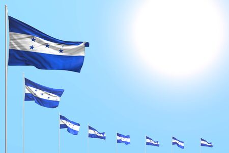 beautiful national holiday flag 3d illustration  - many Honduras flags placed diagonal on blue sky with space for your text
