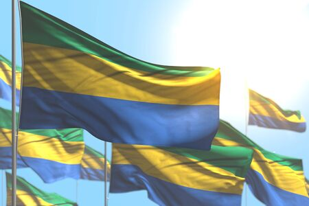 pretty any occasion flag 3d illustration  - many Gabon flags are wave against blue sky photo with selective focus Stok Fotoğraf