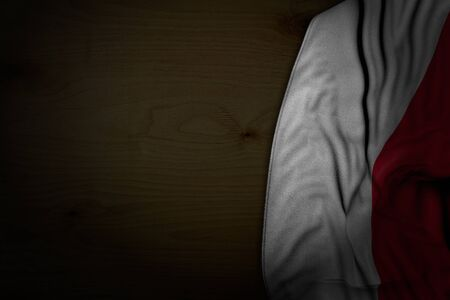 beautiful dark photo of Poland flag with large folds on dark wood with empty place for text - any feast flag 3d illustration
