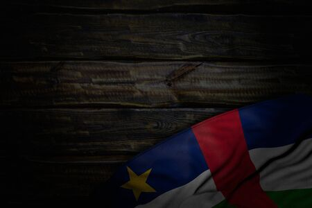 wonderful dark picture of Central African Republic flag with large folds on old wood with empty place for content - any feast flag 3d illustration Banco de Imagens