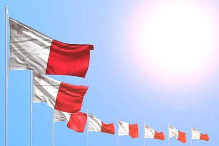 wonderful many Malta flags placed diagonal on blue sky with place for text - any celebration flag 3d illustration