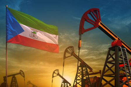 Equatorial Guinea oil industry concept, industrial illustration. Fluttering Equatorial Guinea flag and oil wells on the blue and yellow sunset sky background - 3D illustration