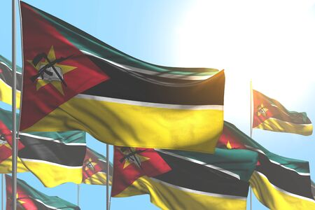 beautiful feast flag 3d illustration  - many Mozambique flags are waving on blue sky background Stok Fotoğraf