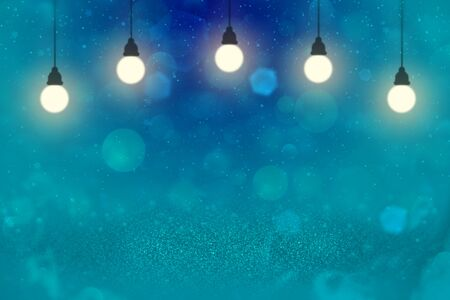 wonderful shining abstract background glitter lights with light bulbs and falling snow flakes fly defocused bokeh - holiday mockup texture with blank space for your content