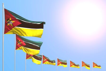 cute many Mozambique flags placed diagonal on blue sky with space for content - any celebration flag 3d illustration  版權商用圖片