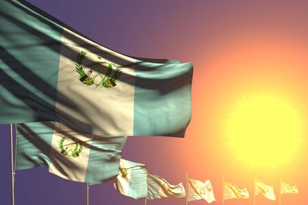 beautiful national holiday flag 3d illustration  - many Guatemala flags placed diagonal on sunset with space for your content
