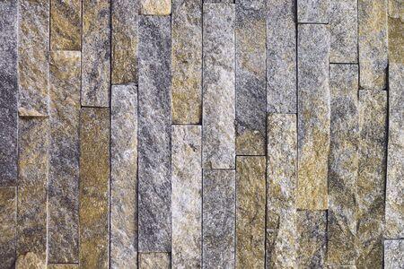 abstract old orange natural quartzite stone bricks texture for design purposes. Banco de Imagens - 131909236