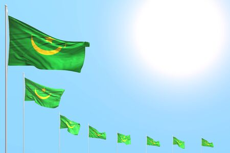 nice many Mauritania flags placed diagonal on blue sky with space for your content - any occasion flag 3d illustration