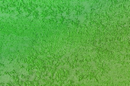 creative grunge green natural stone texture for background use.