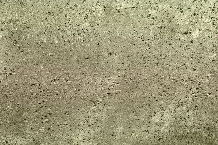 fantastic dotted scratched stucco on the wall texture - abstract photo background