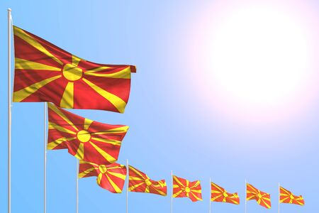 cute holiday flag 3d illustration  - many Macedonia flags placed diagonal on blue sky with place for content Banco de Imagens
