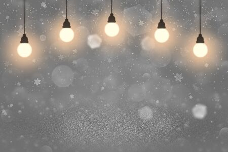 nice brilliant abstract background glitter lights with light bulbs and falling snow flakes fly defocused bokeh - holiday mockup texture with blank space for your content Banco de Imagens