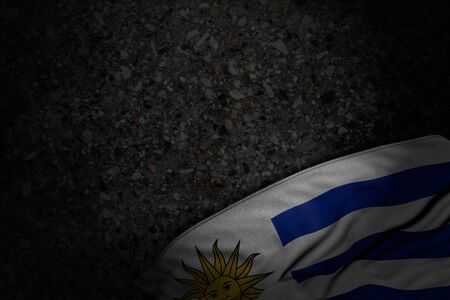 wonderful dark picture of Uruguay flag with large folds on dark asphalt with free space for your text - any occasion flag 3d illustration