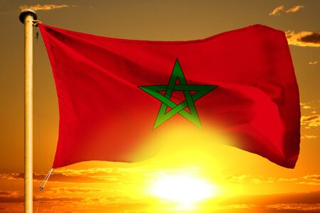 Morocco flag weaving on the beautiful orange sunset background