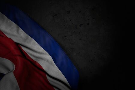 wonderful dark illustration of Costa Rica flag with big folds on black stone with free space for your content - any celebration flag 3d illustration