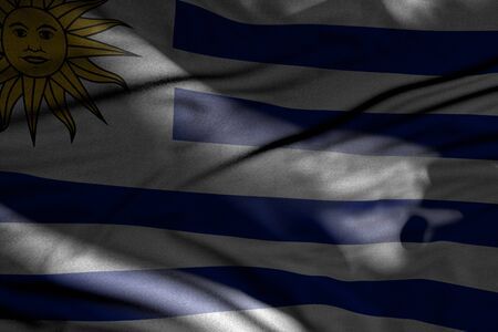 beautiful independence day flag 3d illustration  - photo of dark Uruguay flag with folds lying in shadows with light spots on it