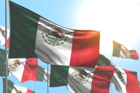 nice many Mexico flags are waving against blue sky photo with bokeh - any occasion flag 3d illustration