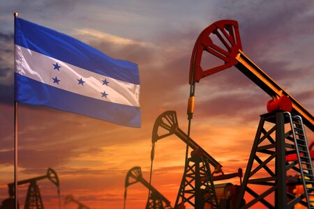 Honduras oil industry concept, industrial illustration. Honduras flag and oil wells and the red and blue sunset or sunrise sky background - 3D illustration 스톡 콘텐츠