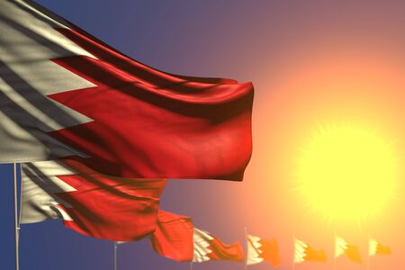 cute many Bahrain flags on sunset placed diagonal with selective focus and place for text - any feast flag 3d illustration  Stok Fotoğraf