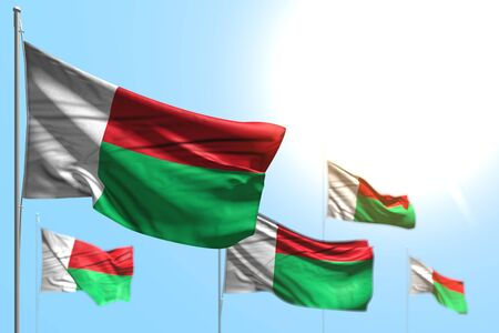 beautiful independence day flag 3d illustration  - 5 flags of Madagascar are waving against blue sky illustration with soft focus