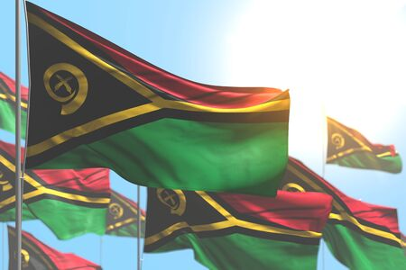 wonderful many Vanuatu flags are waving against blue sky photo with selective focus - any occasion flag 3d illustration