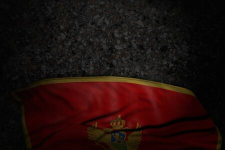 cute any celebration flag 3d illustration  - dark image of Montenegro flag with large folds on dark asphalt with empty space for your content