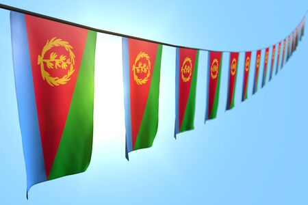 nice any occasion flag 3d illustration  - many Eritrea flags or banners hangs diagonal on rope on blue sky background with bokeh