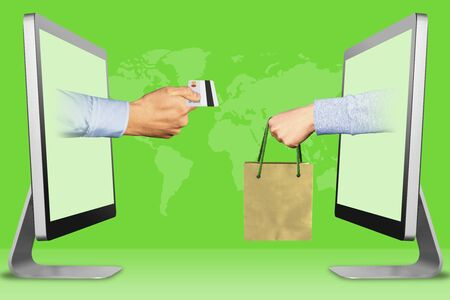 business concept, hands from computers. hand with credit card and hand with shopping bag . 3d illustration