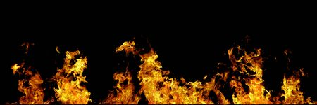 Real fire line flames isolated on black background. Mockup fire wall. 版權商用圖片
