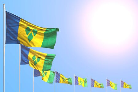nice many Saint Vincent and the Grenadines flags placed diagonal on blue sky with space for your text - any holiday flag 3d illustration Banco de Imagens