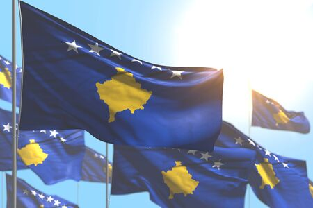 nice any holiday flag 3d illustration  - many Kosovo flags are waving against blue sky photo with soft focus Banco de Imagens