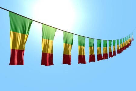 cute anthem day flag 3d illustration  - many Mali flags or banners hanging diagonal on string on blue sky background with bokeh Banco de Imagens