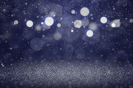 blue nice bright abstract background glitter lights with falling snow flakes fly defocused bokeh - celebratory mockup texture with blank space for your content Фото со стока