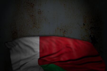 wonderful independence day flag 3d illustration  - dark photo of Madagascar flag with large folds on rusty metal with empty space for your text Banco de Imagens