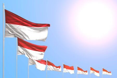 cute independence day flag 3d illustration  - many Indonesia flags placed diagonal on blue sky with place for your text
