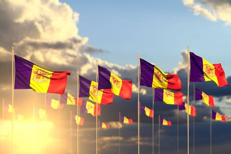 pretty many Andorra flags on sunset placed in row with selective focus and place for text - any holiday flag 3d illustration