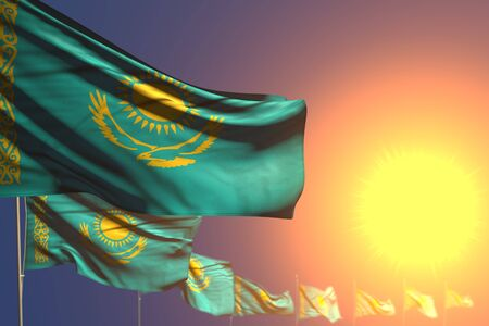 wonderful national holiday flag 3d illustration  - many Kazakhstan flags on sunset placed diagonal with selective focus and place for your text