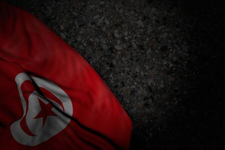 nice dark image of Tunisia flag with big folds on dark asphalt with empty space for your text - any holiday flag 3d illustration