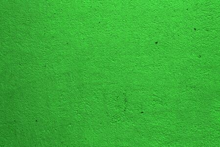 wonderful green grainy grungy stucco on the panel texture - abstract photo background
