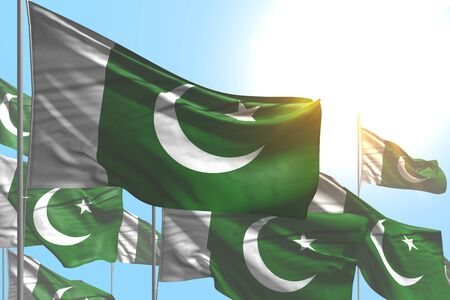 beautiful many Pakistan flags are waving on blue sky background - any celebration flag 3d illustration Imagens