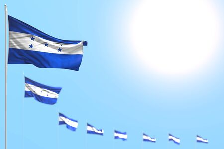 wonderful many Honduras flags placed diagonal with selective focus and empty space for your content - any feast flag 3d illustration  Imagens