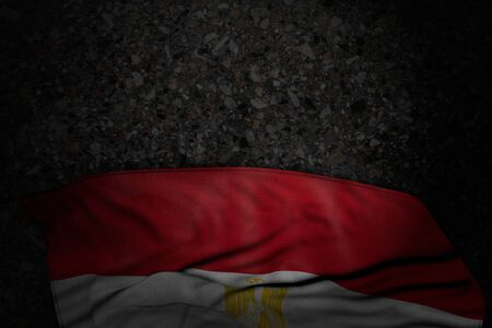 cute dark illustration of Egypt flag with big folds on dark asphalt with free place for text - any occasion flag 3d illustration 写真素材