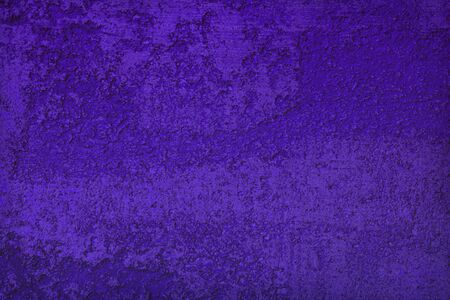 abstract vintage purple travertine like stucco texture for use as background.