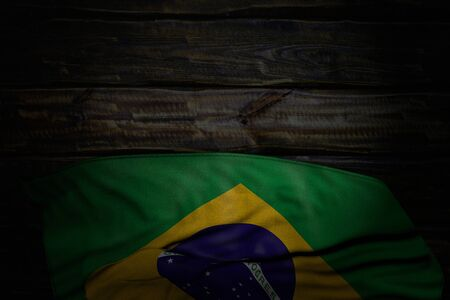 cute dark picture of Brazil flag with large folds on old wood with free space for content - any celebration flag 3d illustration