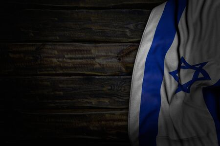 nice dark photo of Israel flag with large folds on old wood with empty place for content - any celebration flag 3d illustration Banco de Imagens