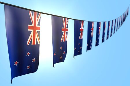 beautiful many New Zealand flags or banners hanging diagonal on rope on blue sky background with selective focus - any occasion flag 3d illustration